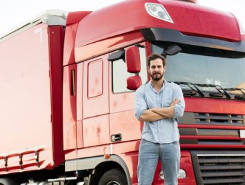 man_standing_in_front_of_truck