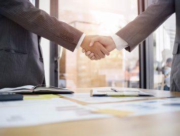 business handshake between lender and borrower